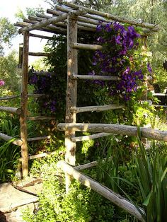 The pergola kits are the easiest and quickest way to build a garden pergola. There are lots of do it yourself pergola kits available to you so that anyone could easily put them together to construct a new structure at their backyard. Garden Archway, Garden Entrance, Garden Arbor, Garden Trellis, Hops Trellis, Garden Doors, Rustic Gardens, Outdoor Gardens, Rustic Arbor