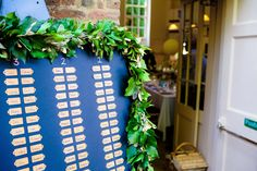 Ivy etc (cheap!) around the board with table numbers