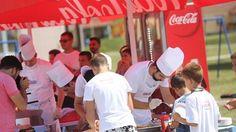 chefs prepare food for children at Coca-Cola event