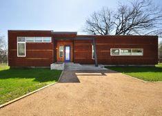 Custom prefab modular house with patinated metal facade, Austin, Texas: Modern Prefab Modular Homes - Prefabium