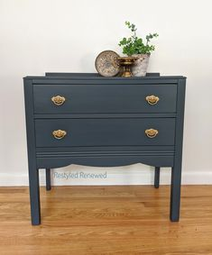 This is a mix of a navy blue and a dark gray. It's a custom mix I often do.  I used Annie Sloan chalk paint. Annie Sloan graphite and Annie Sloan napoleonic blue chalk paint.  Custom furniture artist.
