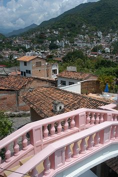 "Casa Kimberley, which is located in the middle of the old town area of Puerto Vallarta, Mexico. Richard Burton bought the villa as a gift for Liz Taylor on her 34th birthday. Later they purchased a second villa across the road and built the pink bridge to connect the two properties. This was their love nest when Richard Burton was on location to film ""The Night of the Iguana"""