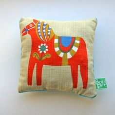 i like pillows like this; not too childish but has a certain feel for that ; more cultural perhaps and artsy