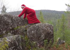 https://flic.kr/p/MKnbG7 | Mrs Santa Claus Finland climbing on the rocks | Photo by T. Pohjanvesi.