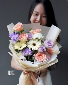 Arranged with love these pastel hues flower bouquet consisting of roses, carnations, gerberas & eutomas Hydrangea Bouquet, Lily Bouquet, Hand Bouquet, Flower Bouquets, Bouquet Delivery, Same Day Flower Delivery, Blue Roses, Calla Lily, Carnations