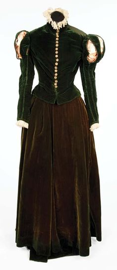 """Katharine Hepburn """"Mary Stuart"""" dark green period dress by Walter Plunkett from Mary of Scotland. (RKO, 1936) Dark green silk velvet two-piece period dress with gold metal buttons and two petticoats. Handwritten label """"Hepburn C-1510."""" Worn by Katharine Hepburn as """"Mary Stuart"""" when Bothwell leaves the country to save her throne in Mary of Scotland."""