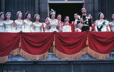 The Coronation: The new Queen waves from the balcony, next to Prince Charles, Princess Anne, Prince Philip, and the Queen Mother. Elizabeth's younger sister Margaret is beside her among the ladies on the left