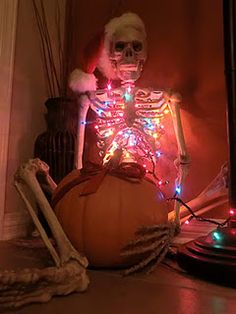 Neat idea to put a string of Christmas or even orange Halloween lights inside a skeleton!