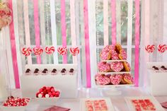 hot pink and white dessert table: i love the heart shaped donuts