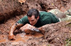 All hands on deck: Henry looked a picture of determination as he waded through the mud lyi...
