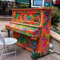 Local artists paint pianos in Old Town Fort Collins, Colorado.