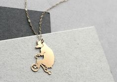 bear on tricycle necklace by WildThingStudio on Etsy, $58.00