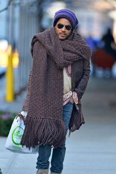 Lenny Kravitz fights the winter chill with a giant scarf and knit hat, as he goes out and about in New York City on November 23, 2012.