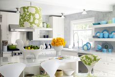"""Jonathan Adler covered this Westchester kitchen's pendant light in Alan Campbell's Potalla fabric. He says that it's """"sort of crisply modern and floral-viney at the same time — perfect for the country."""""""