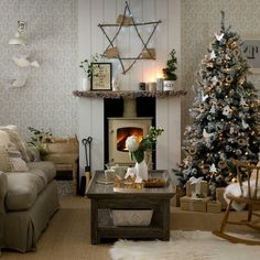 Gorgeous Christmassy Living room with wooden fireplace and log burner