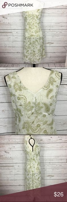 """Pineapple Moon Paisley Sleeveless Lined Dress Pretty olive green and cream paisley/floral lined, v-neck dress. Excellent pre-owned condition. Bust: 39 1/2""""; length in the back from the shoulder to the hem: 39"""". Measurements are approximate and were taken laying flat, unstretched. Smoke free home. 🌺Thank you for shopping my closet 😊🌺 Pineapple Moon Dresses"""