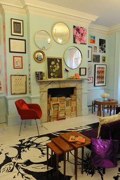 Mint walls + salon style hanging + fireplace full of books = perf
