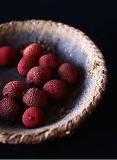 """OMG! our local fire department has a tree growing in front of their station.  They have these fruit on it that look JUST like this, but no one knows what they are! I wonder if this is it! """"Lychees""""?"""