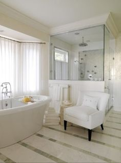 maybe not all the white but that layout is nice and that tub and shower are to die for plus I like the chair by the tub idear