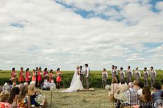 Breathtaking wedding ceremony in the brides family wheat feild. Love how the prarie sky goes on to infinity!