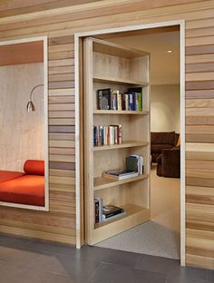 11. a bookshelf passage - WHAT A GREAT READING NOOK ON THE LEFT. - This is in the Lake Wenatchee house in Portland, Oregon. A hidden room and passages behind this regular bookshelf. Perfect for sneaking in undetected, and the room behind the bookshelf looks pretty cozy too.