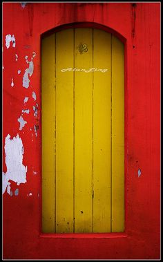 In case the bright yellow of this door isn't enough to catch your eye, the wall surrounding it is an equally dramatic red. The door is actually the back entrance to a shop house down an alley in Singapore. Cool Doors, Unique Doors, Portal, Entrance Doors, Doorway, Inspiration Artistique, When One Door Closes, Yellow Doors, Back Doors