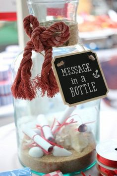 We could have a marriage advice, message in a bottle set up where guests can write on pieces of paper and put it in the bottle for us to open later. I have some large vases and we would just need sand, rope or twine, and some message paper.