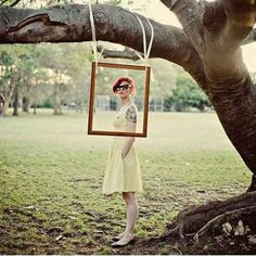 Just a photo frame dangling from ribbons off of a tree can also serve as a cheap and easy photo booth.   32 Totally Ingenious Ideas For An Outdoor Wedding by WeAreAllMadHere