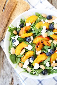 Grilled Peach, Blueberry, and Goat Cheese Arugula Salad Recipe on twopeasandtheirpod.com The perfect summer salad!