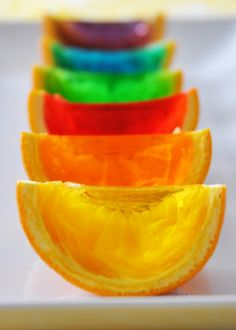 Rainbow Gelatin Orange Wedges!  In the comments people suggested using Jello Jigglers recipe and also turning them into sailboats for a kids party by adding a toothpick and sail!  Awesome!
