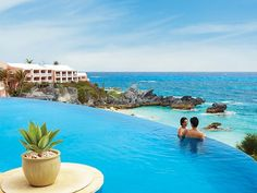 The infinity pool at the Reefs Hotel & Club, Southampton, Bermuda  What You'll See: The Reefs is home to two infinity pools (one in the hotel area, the other in the condo section), both of which sit atop a cliff, providing guests with uninterrupted views of turquoise water and coral reefs, not to mention stunning sunsets.
