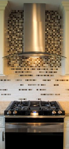 Collamore Built | Residential Design and Construction: Creative Ombre Mosaic Tile with Modern Stainless Steel Hood.