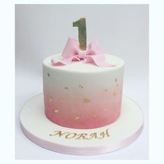 Simple And Beautiful Pink Fading Into White Coloured Icing With Bow Cake Topper 1st Birthday