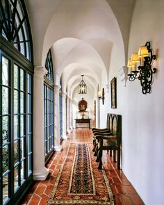 An existing gallery is the only portion of the existing house thought to be attributed to George Washington Smith and is used to organize all the circulation in the house. Tile, lighting, and all furnishings are new and were inspired by George Washington Smith's own designs. Charles White photo.