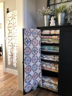 What a lovely way to display your antique quilt collection.