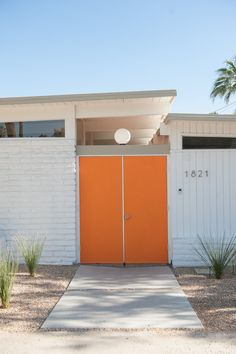neutra numbers / sherin williams SW 6885 knockout orange / concrete pads / aggregate / grasses