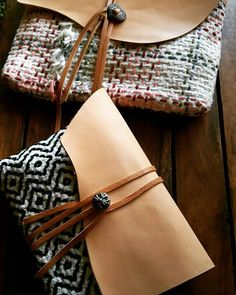 """regular criss-cross sashiko in three colors gives the impression of handwoven cloth in this clutch by Michiko Oba of Fukuoka, Japan. Her trademark is hananiwa.sashiko and he blogs at obamychiko.blog109.fc2.com   The """"Twill"""" clutch in foreground is done with black stitches only."""
