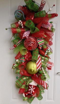 Deco mesh Swag - Made by V Williams 2013 Christmas Swags, Xmas Wreaths, Deco Mesh Wreaths, Christmas Crafts, Merry Christmas, Spring Wreaths, Christmas Ideas, Swag Ideas, Wreath Ideas
