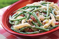 Green Bean, Grape, and Pasta Toss - Our Best Barbecue Side Dishes - Southernliving. Recipe: Green Bean, Grape, and Pasta Toss If you like broccoli salad, you will love this colorful red-and-green salad. Savory bacon and crunchy chopped pecans add texture and saltiness to the creamy-dressing-coated dish. Creamy mayonnaise, sugar, and tangy red wine vinegar combine in a sweet yet sharp dressing. Seedless red grapes bring sugary sweetness that will bursts in your mouth. Cook the pasta al…