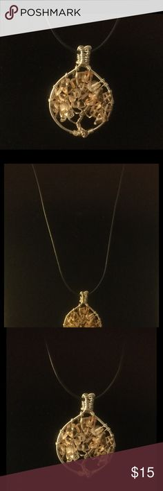 """Tree of Life pendant 18"""" Tree of Life pendant 18"""" Black cord chain and made with silver wire and gold quartz stones. Jewelry Necklaces"""