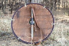 Functional period Viking's shield with leather exterior and stainless steel boss. Shield is decorated with brass accents. Available in: brown leather, black leather, brass Viking Dragon, Viking Art, Viking Shield Design, Viking Clothing, Knives And Swords, Weapons, Brown Leather, Exterior, Stainless Steel
