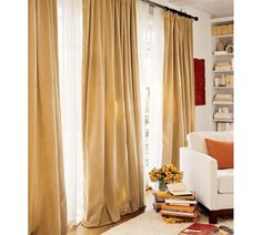 Want to find caramel colored suede drapes, perhaps a little less yellow than these.