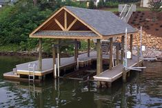 The Boathouse: a new definition to lakefront living! Lake Dock, Boat Dock, Lakefront Property, Boat Slip, River House, Boat Plans, Boat Building, Rustic Design, Outdoor Living