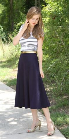 mid-length skirt, stripes, heels.: