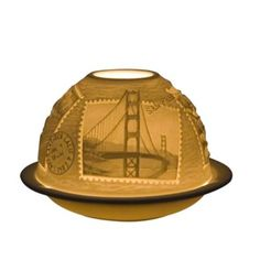 """Light up your decor with a luminous votive from Bernardaud, intricately adorned with breathtaking images of San Francisco hotspots.   Porcelain   Dishwasher & microwave safe   Imported   4""""W x 2.75""""H"""