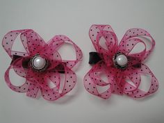 Set of 2 pink and black polka dot bows with unique pearl buttons on covered alligator clips for $10.50!!