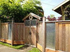 corregated metal fence   ... panels of wood slats mixed with panels of corrugated metal and