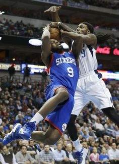 Philadelphia 76ers shooting guard James Anderson (9) is defended by Dallas Mavericks small forward Jae Crowder (9) during the first half of an NBA basketball game in Dallas, Monday, Nov. 18, 2013. (AP Photo/LM Otero)