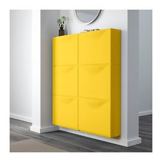 TRONES Shoe/storage cabinet - yellow - IKEA  This can be stacked vertically or horizontally or used singly. Each unit has recessed top. Can be hung at different heights, very slim profile, in bright yellow, black and white.