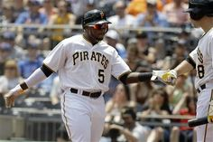 Pittsburgh Pirates' Josh Harrison (5) heads back to the dugout...